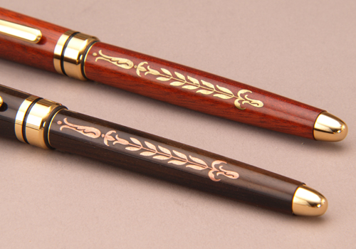 Pens inlaid with copper and brass