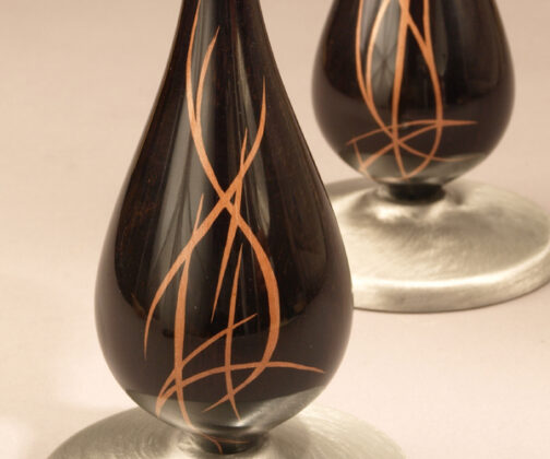 ebony candlesticks with copper metal inlay