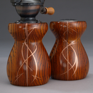 Antique salt and pepper mills inlaid with copper