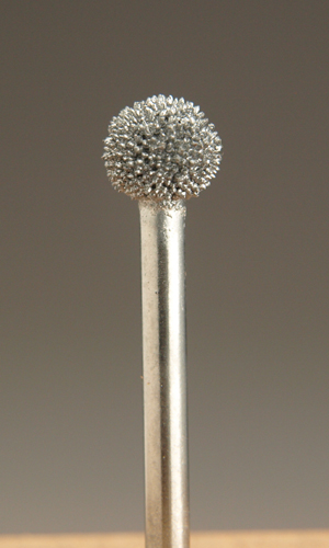 kutzall 1/4 inch spherical burr for the controlled removal of wood with a rotary tool.