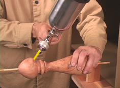 Spraying a Urethane clear on a peppermill on Brilliant Finishes for Woodturners