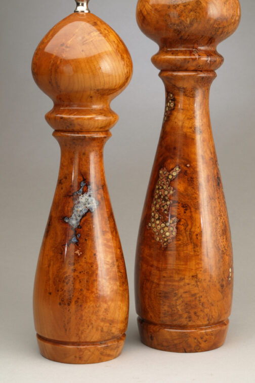 "Detail of 12"" and 10"" cherry burl salt and peppermills with salt and peppercorn inlay by Ted Sokolowski"