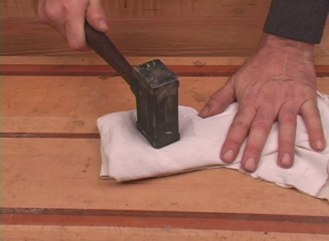 Pulverizing shellac in cotton cloth
