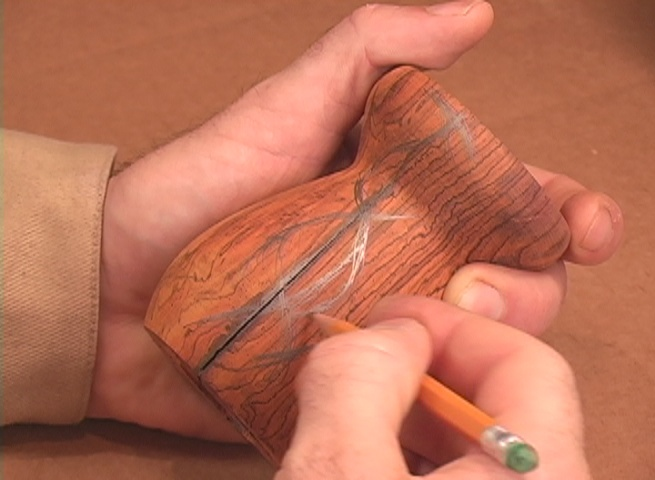 Sketching lines on form for carving for metal inlay