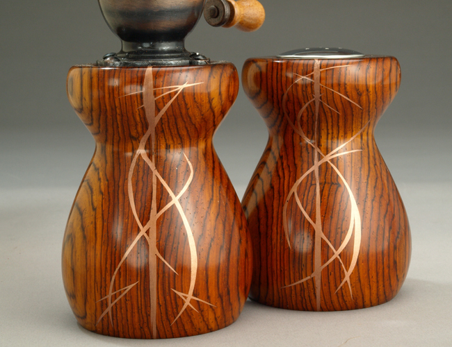 Carved wood with copper metal inlay