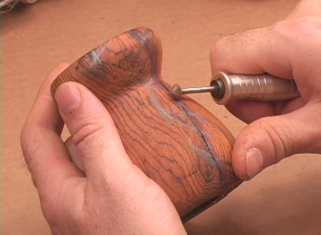 Use a supporting thumb to establish curves while carving